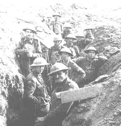 A group of Diggers in a trench in France. Fully armed and ready to go.